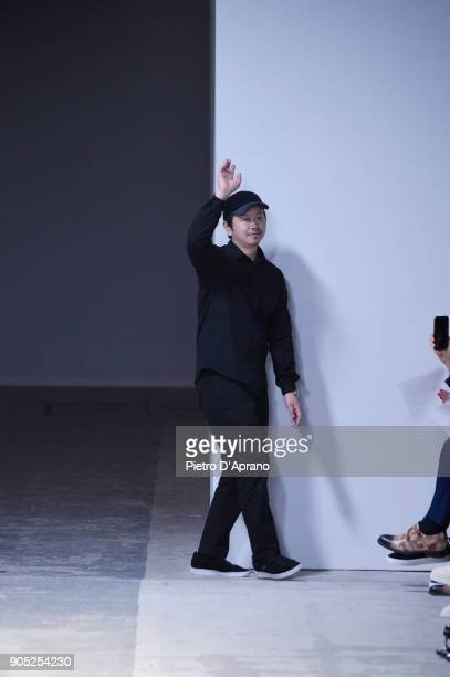 Yosuke Aizawa acknowledges the applause of the audience after Hunting World show during Milan Men's Fashion Week Fall/Winter 2018/19 on January 15...