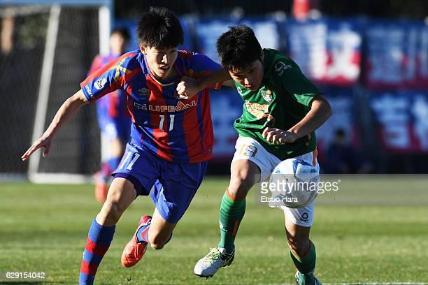 Yosuke Hanya#11 of FC Tokyo U-18 and Shinichiro Osanai#13 of Aomori Yamada compete for the ball during the Prince Takamado Trophy U-18 Premier League...