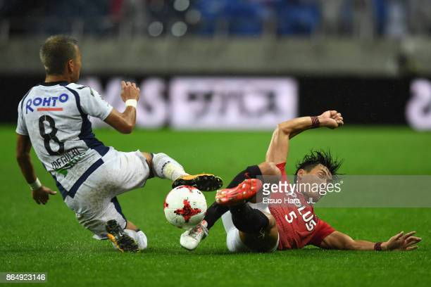 Yosuke Ideguchi of Gamba Osaka and Tomoaki Makino of Urawa Red Diamonds compete for the ball during the JLeague J1 match between Urawa Red Diamonds...