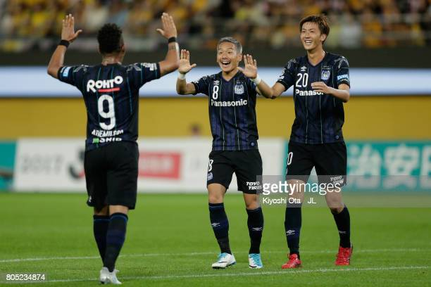 Yosuke Ideguchi of Gamba Osaka celebrates scoring his side's second goal with his team mates Ademilson and Shun Nagasawa during the J.League J1 match...
