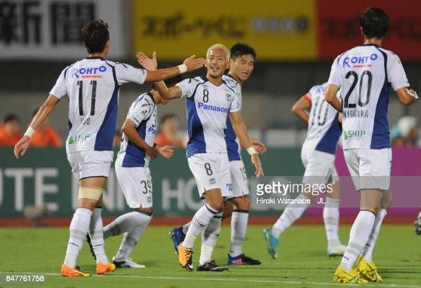 Yosuke Ideguchi of Gamba Osaka celebrates scoring the opening goal with his team mates during the JLeague J1 match between Omiya Ardija and Gamba...