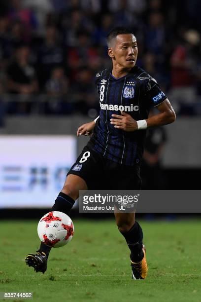 Yosuke Ideguchi of Gamba Osaka in action during the JLeague J1 match between Gamba Osaka and Kashiwa Reysol at Suita City Football Stadium on August...