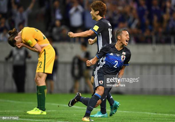 Yosuke Ideguchi of Japan celebrates scoring his side's second goal while Jackson Irvine of Australia shows dejection during the FIFA World Cup...
