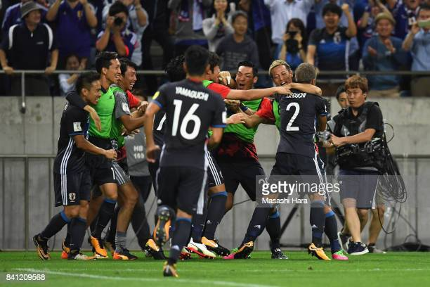Yosuke Ideguchi of Japan celebrates scoring his side's second goal with his team mates during the FIFA World Cup Qualifier match between Japan and...
