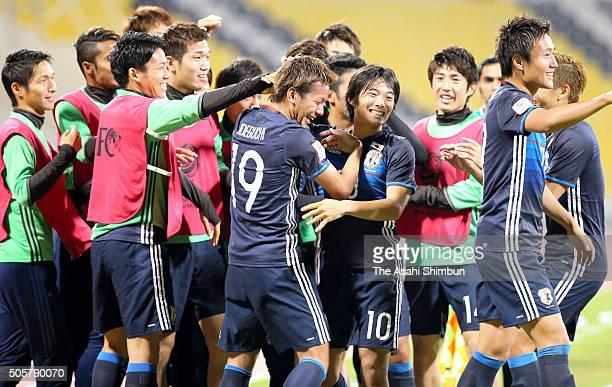 Yosuke Ideguchi of Japan celebrates scoring his team's second goal with his team mates during the AFC U23 Championship Group B match between Saudi...