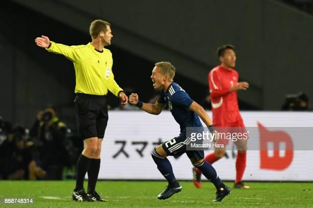 Yosuke Ideguchi of Japan celebrates scoring the opening goal during the EAFF E1 Men's Football Championship between Japan and North Korea at...