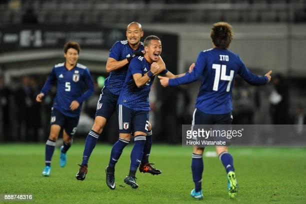 Yosuke Ideguchi of Japan celebrates scoring the opening goal with his team mates during the EAFF E1 Men's Football Championship between Japan and...