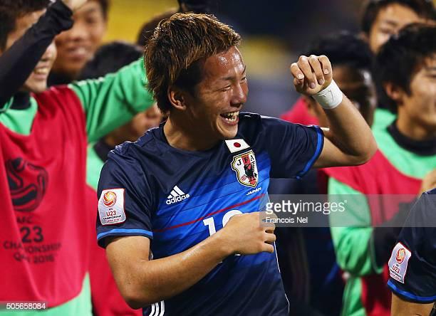 Yosuke Ideguchi of Japan celebrates with team mates as he scores their second goal during the AFC U23 Championship Group B match between Saudi...