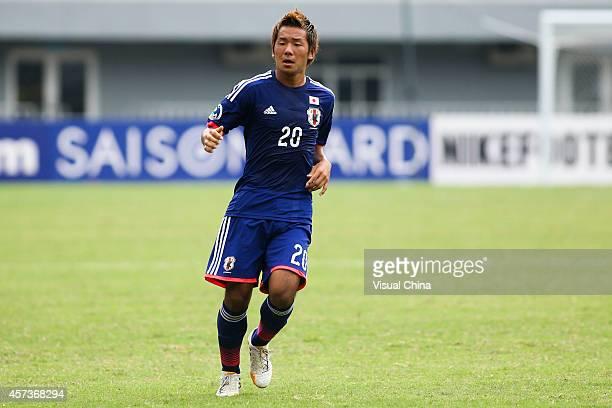 Yosuke Ideguchi of Japan in action during the AFC U19 Championship quarterfinal match between Japan and North Korea at Wunna Theikdi Stadium on...