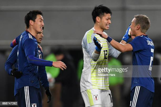 Yosuke Ideguchi of Japan is congratulated by his team mates after their 10 victroy in the EAFF E1 Men's Football Championship between Japan and North...