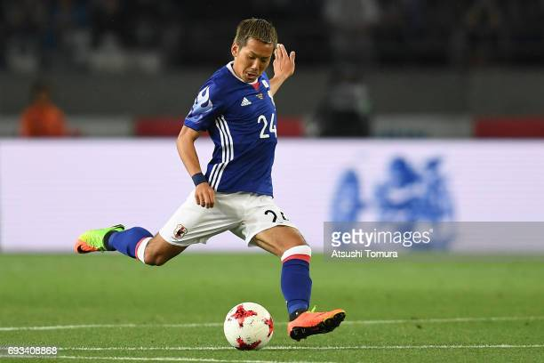 Yosuke Ideguchi of Japan runs with the ball during the international friendly match between Japan and Syria at Tokyo Stadium on June 7 2017 in Chofu...