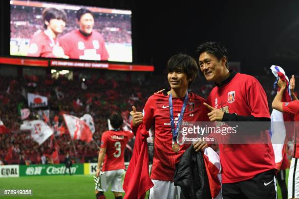 Yosuke Kashiwagi and Tadanari Lee of Urawa Red Diamonds celebrate after the AFC Champions League Final second leg match between Urawa Red Diamonds...