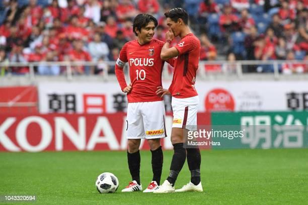Yosuke kashiwagi and Tomoaki Makino of Urawa Red Diamonds look on during the JLeague J1 match between Urawa Red Diamonds and Kashiwa Reysol at...
