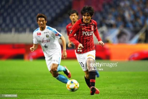 Yosuke Kashiwagi of Urawa Red Diamonds and Hidemasa Morita of Kawasaki Frontale compete for the ball during the J.League J1 match between Urawa Red...