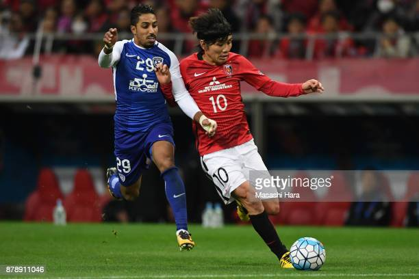 Yosuke Kashiwagi of Urawa Red Diamonds and Salem Al Dawsari of AlHilal compete for the ball during the AFC Champions League Final second leg match...