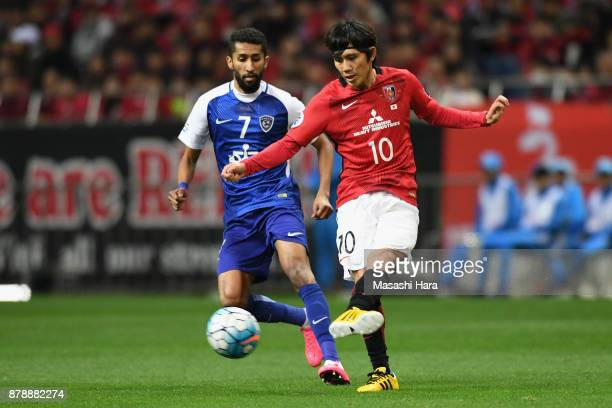 Yosuke Kashiwagi of Urawa Red Diamonds and Salman Al Faraj of AlHilal compete for the ball during the AFC Champions League Final second leg match...
