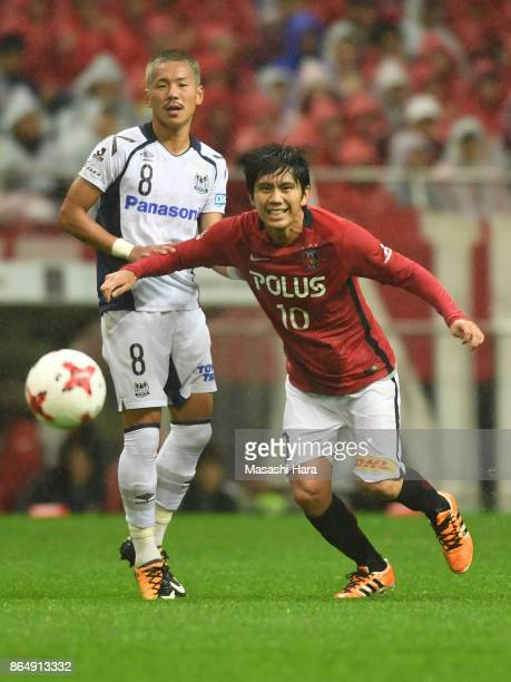 Yosuke Kashiwagi of Urawa Red Diamonds and Yosuke Ideguchi of Gamba Osaka compete for the ball during the JLeague J1 match between Urawa Red Diamonds...