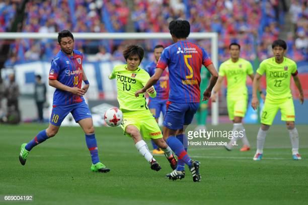 Yosuke Kashiwagi of Urawa Red Diamonds and Yuichi Maruyama of FC Tokyo compete for the ball during the J.League J1 match between FC Tokyo and Urawa...