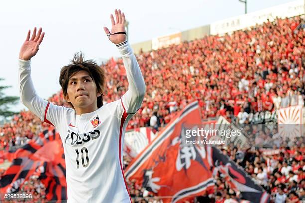 Yosuke Kashiwagi of Urawa Red Diamonds applauds supporters after his team's 10 win in the JLeague match between Omiya Ardija and Urawa Red Diamonds...