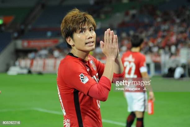Yosuke Kashiwagi of Urawa Red Diamonds applauds supporters after his side's 43 victory in the JLeague J1 match between Urawa Red Diamonds and...