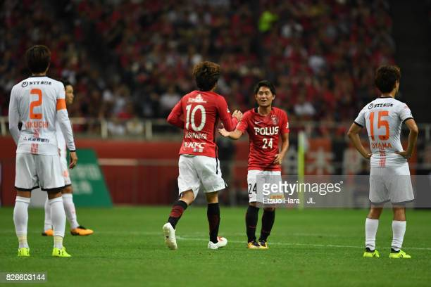 Yosuke Kashiwagi of Urawa Red Diamonds celebrates scoring his side's second goal with his team mate Takahiro Sekine during the JLeague J1 match...
