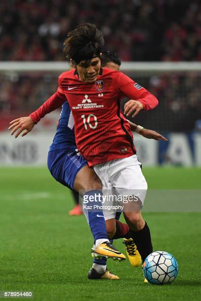 Yosuke Kashiwagi of Urawa Red Diamonds is fouled by Salem Al Dawsari of AlHilal during the AFC Champions League Final second leg match between Urawa...
