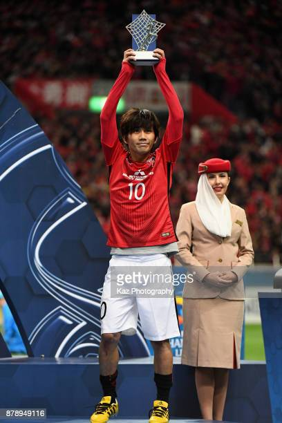 Yosuke Kashiwagi of Urawa Red Diamonds lifts the trophy after receiving the most Valuable Player Award during the AFC Champions League Final second...