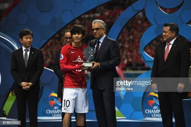 Yosuke Kashiwagi of Urawa Red Diamonds receives the most Valuable Player Award by the Asian Football Confederations President Shaikh Salman bin...