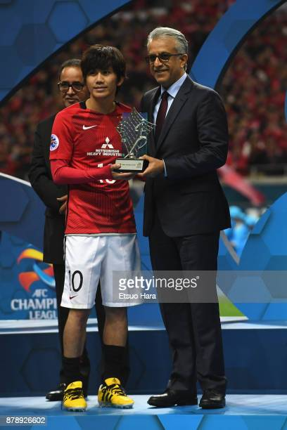 Yosuke Kashiwagi of Urawa Red Diamonds receives the most Valuable Player Award by the Asian Football Confederations President Shaikh Salman bin...