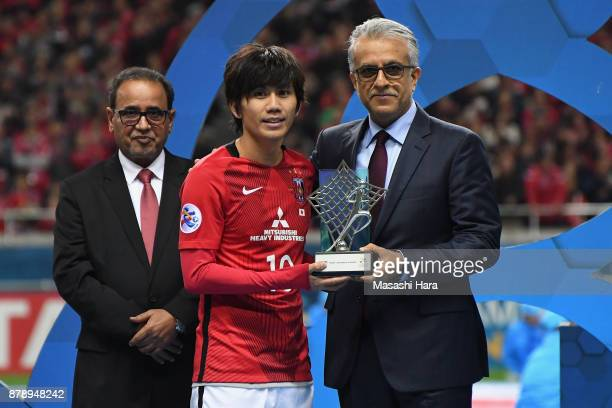 Yosuke Kashiwagi of Urawa Red Diamonds receives the most Valuable Player Award by the Asian Football Confederation President Shaikh Salman bin...