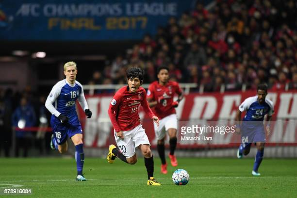 Yosuke Kashiwagi of Urawa Red Diamonds runs with the ball during the AFC Champions League Final second leg match between Urawa Red Diamonds and...