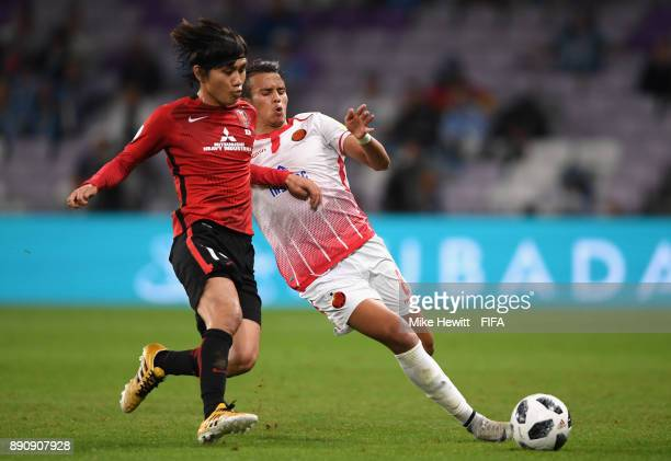 Yosuke Kashiwagi of Urawa Reds and Badr Gaddarine of Wydad Casablanca during the FIFA Club World Cup UAE 2017 fifth place playoff match between Wydad...