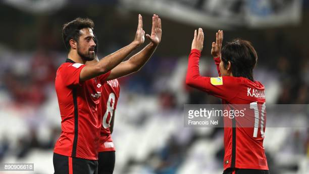 Yosuke Kashiwagi of Urawa Reds celebrates scoring his team's second goal with Mauricio Antonio during the FIFA Club World Cup UAE 2017 fifth place...