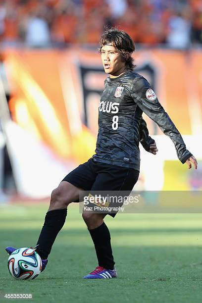 Yosuke Kashiwagi of Urawa Reds in action during the JLeague match between Shimizu SPulse and Urawa Red Diamonds at Ecopa Stadium on September 13 2014...