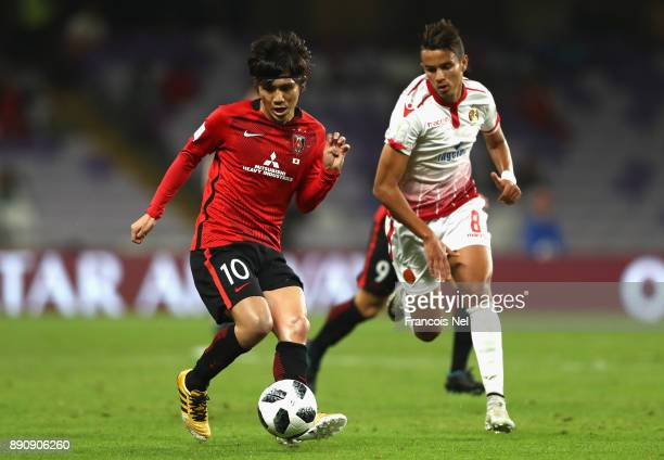 Yosuke Kashiwagi of Urawa Reds is closed down by Badr Gaddarine of Wydad Casablanca during the FIFA Club World Cup UAE 2017 fifth place playoff match...