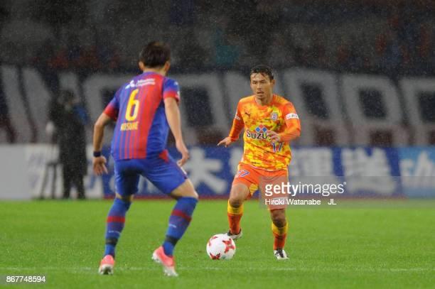 Yosuke Kawai of Shimizu SPulse takes on Kosuke Ota of FC Tokyo during the JLeague J1 match between FC Tokyo and Shimizu SPulse at Ajinomoto Stadium...