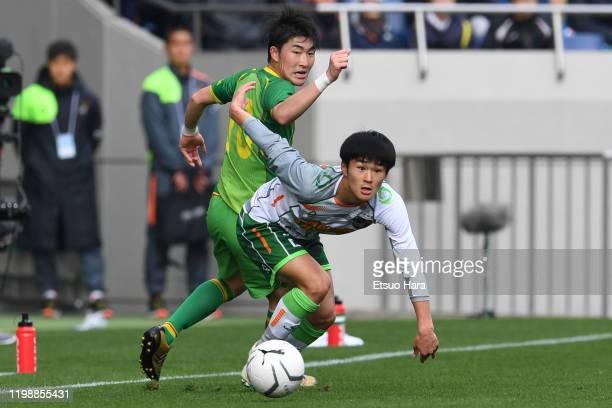 Yosuke Uchida of Aomori Yamada and Misaki Haruyama of Teikyo Nagaoka compete for the ball during the 98th All Japan High School Soccer Tournament...