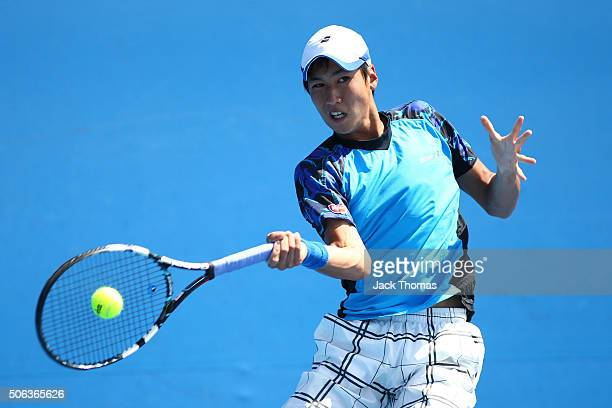 Yosuke Watanuki of Japan plays a forehand in his first round juniors match against Chienhsun Lo of Chinese Taipei during the Australian Open 2016...