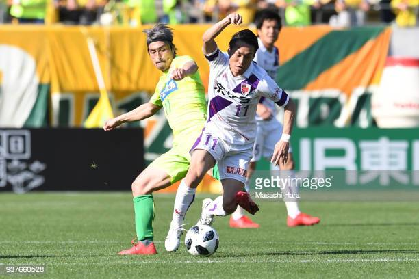 Yosuke Yuzawa of Kyoto Sanga and Takayuki Funayama of JEF United Chiba compete for the ball during the JLeague J2 match between JEF United Chiba and...