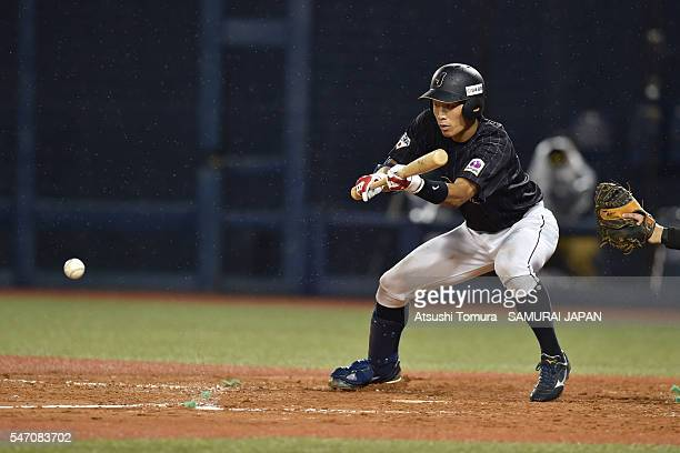 Yota Kyoda of Japan attempts to bunt in the top half of the fifth inning during the day 2 match between USA and Japan during the 40th USAJapan...