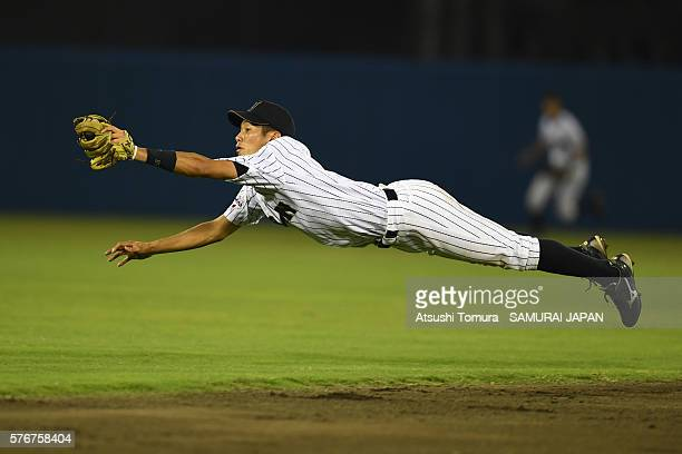 Yota Kyoda of Japan dives to catch the ball in the top of fourth inning on the day 4 match between Japan v USA during the 40th USAJapan International...