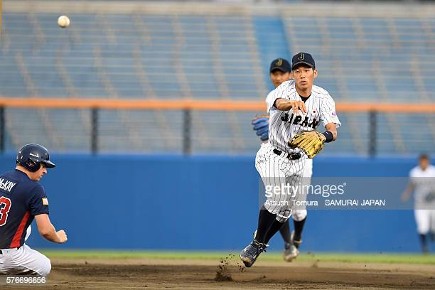 Yota Kyoda of Japan turns a double play in the top half of the 1st inning on the day 4 match between Japan v USA during the 40th USAJapan...