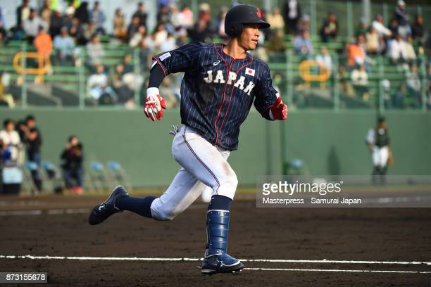 Yota Kyoda of Samurai Japan runs to first base during the practice game between Japan and Hokkaido Nippon Ham Fighters at Sokken Stadium on November...