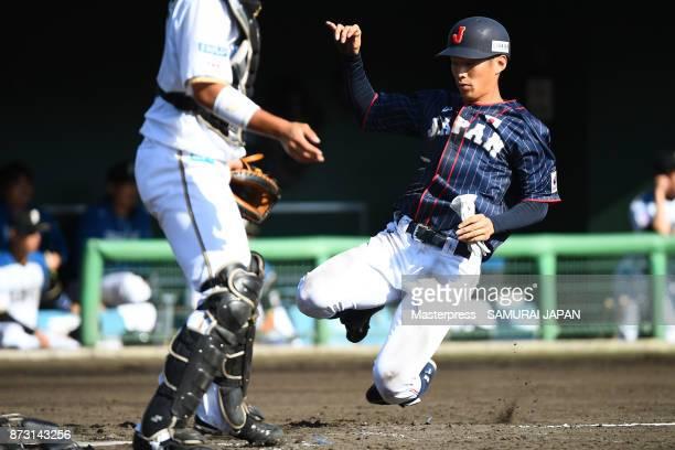 Yota Kyoda of Samurai Japan scores a run during the practice game between Japan and Hokkaido Nippon Ham Fighters at Sokken Stadium on November 12...