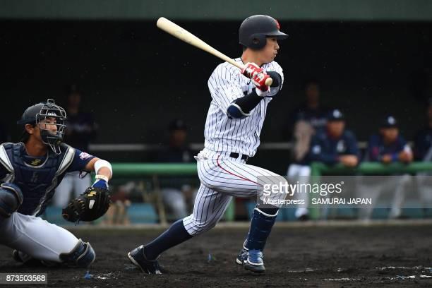 Yota Kyoda of Samurai Japan swings at a pitch during a practice game between Japan and Saitama Seibu Lions at Sokken Stadium on November 13 2017 in...