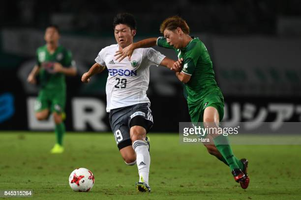 Yota Shimokawa of Matsumoto Yamaga and Koki Anzai of Tokyo Verdy compete for the ball during the JLeague J2 match between Tokyo Verdy and Matsumoto...