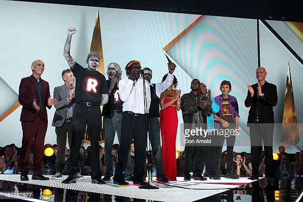 Yothu Yindi accept their induction into the ARIA Hall of Fame with Paul Kelly and Peter Garrett on stage during the 26th Annual ARIA Awards 2012 at...