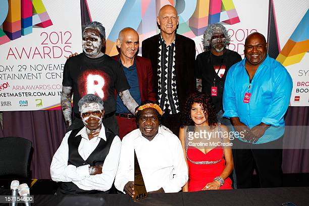 Yothu Yindi, Australian musician, environmentalist, activist and politician Peter Garrett and Paul Kelly pose after Yothu Yindi was inducted into the...