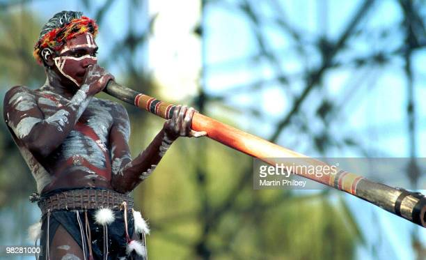 Yothu Yindi perform on stage with a member playing didgeridoo at the F1 Grand Prix in March 1997 in Melbourne Australia