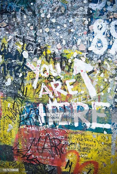 You are here written Berlin Wall, graffiti painting
